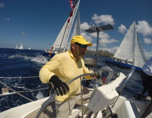 Sag Harbor Yacht Yard owner Lou Grignon at the wheel during Antigua Sailing Week.
