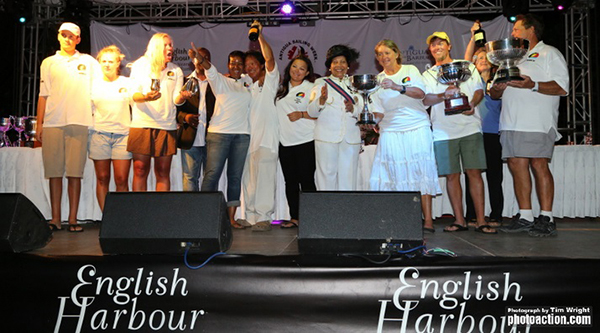 Antigua's Bernie Evan-Wong and crew collecting their trophies during Antigua Sailing Week 2014.  Photo credit- Tim Wright